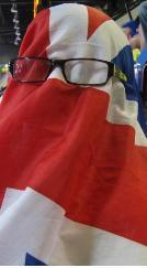 An Olympic spectator covered in a GB flag over her head