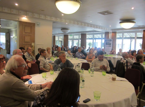 A packed out room of eager listeners