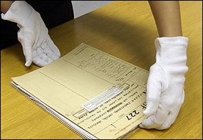 Bulky gloves like these can make handling documents more difficult