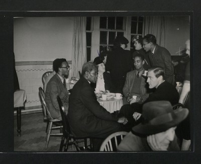 Illustrating the simplicity of a chat over a cuppa - CO 1069, London, 1945: Opening of the Victoria League Colonial Students, Hostel, Nutford House, Nutford Place. Visitors having tea with students after the opening ceremony.