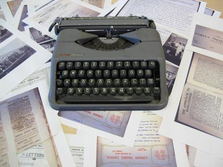 Image of a typewriter and photocopies of varied National Archives records used in the workshop.