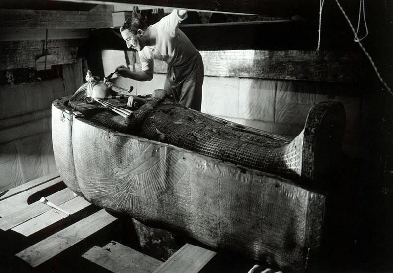 Howard Carter in King Tutankhamen's tomb. Harry Burton, copyright expired