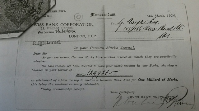 Notice of account closure with attached banknote