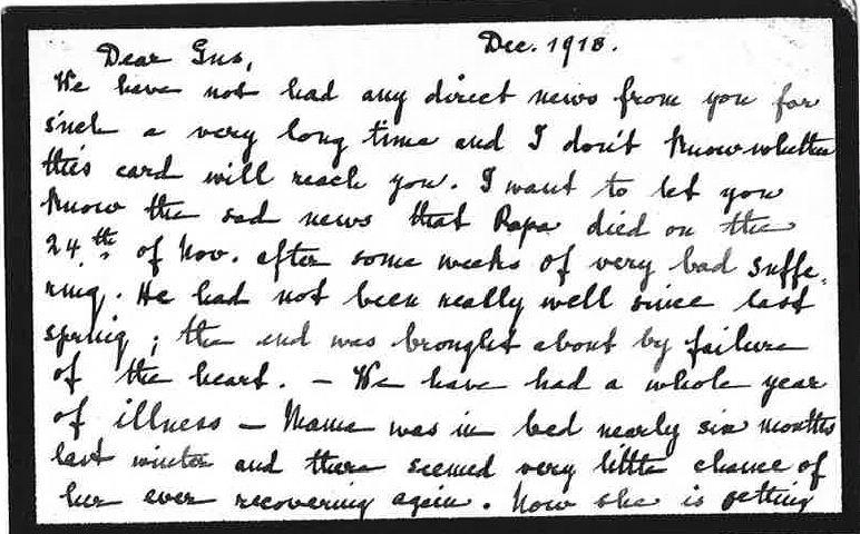 A small black-bordered handwritten letter
