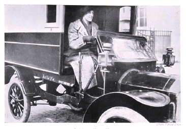 Photograph of a women driving a motor van from the government publication Women's War Work, September 1916. Catalogue reference: MH 47/142/1