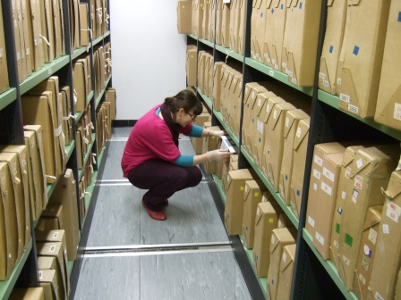 Dr Helen Wilson inspecting a dust monitor in a repository