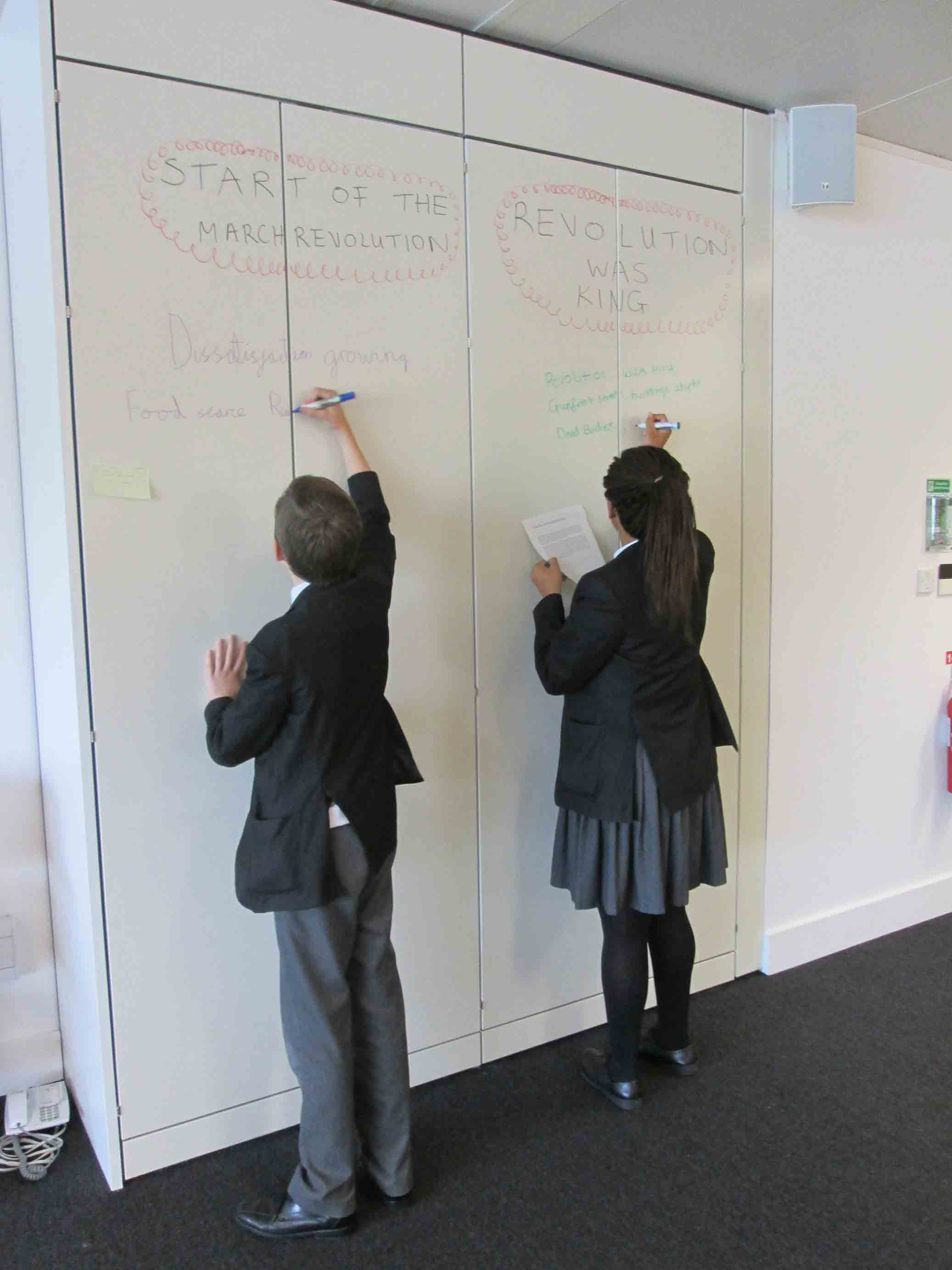 Students from the Wren Academy plan their dramatisation. Image courtesy of Wren Academy.