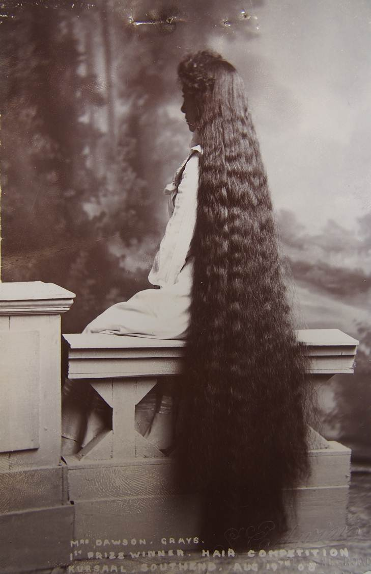 COPY 1/525/95  Photograph of Miss Alice Gertrude Dawson of Grays, back view on parapet showing hair that reaches to heels.