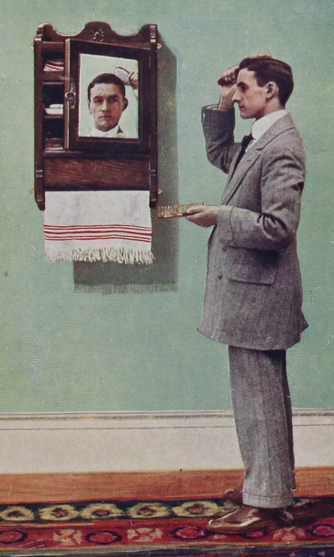 Photograph of man combing his hair and standing before a toilet cabinet, with his reflection in the mirror. Coloured reproduction annexed (catalogue reference: COPY 1/548/138)