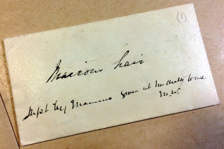 An image of an envelope labeled 'precious hair' from the papers of William Evelyn Wylie (reference: PRO 30/89/37/1)
