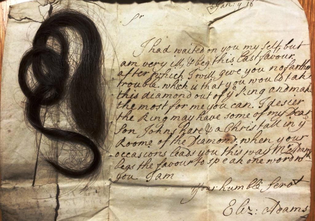 An image of a letter enclosing a lock of hair (still present) to be placed in a crystal for a ring from the case COPE v COPE (reference: C 104/197)