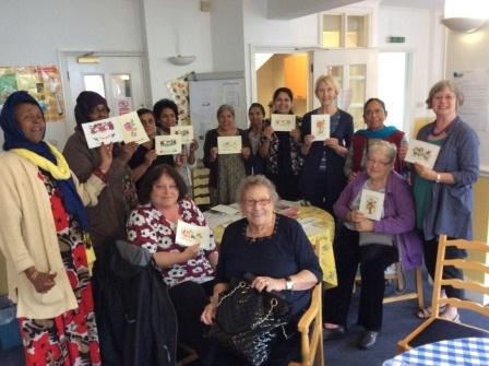 Group members holding up their completed cards