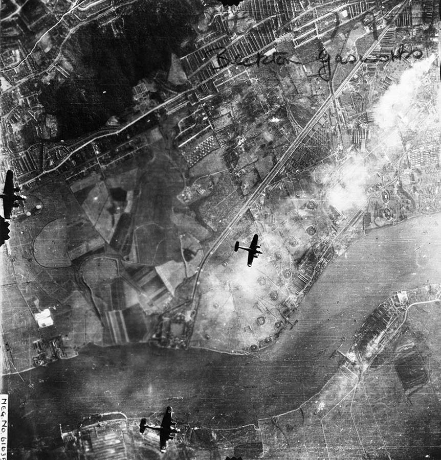 Aerial photograph of the Beckton Gasworks in London on 7 September 1940; three German bombers are visible (catalogue reference: AIR 34/734)