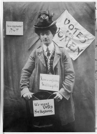 Mr C W Bryce the photographer dressed as a suffragette. Catalogue Reference: COPY 1/504/38454