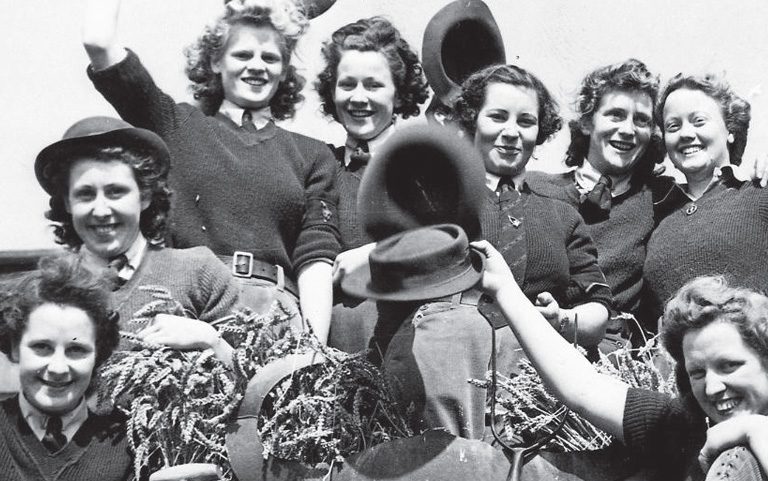 Image of eight woman in a Women's Land Army Parade, World War II