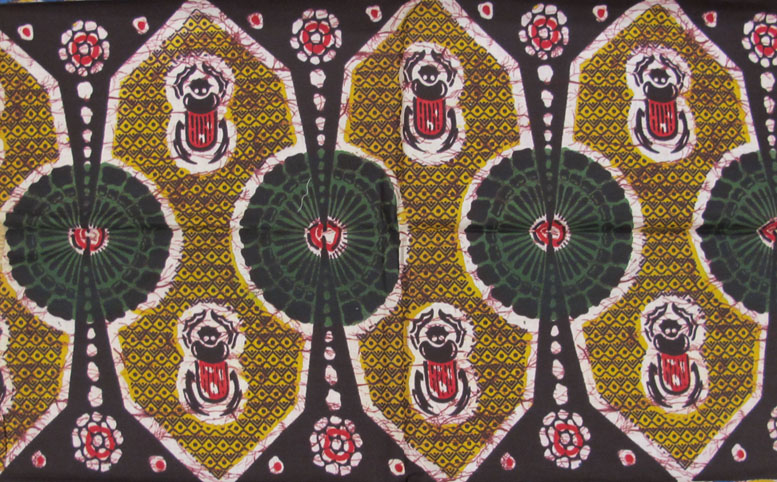 Image of a batik-style textile sample with red beetle design