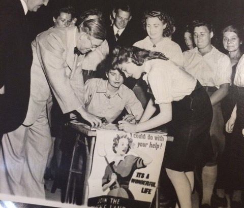 Image of a woman signing up