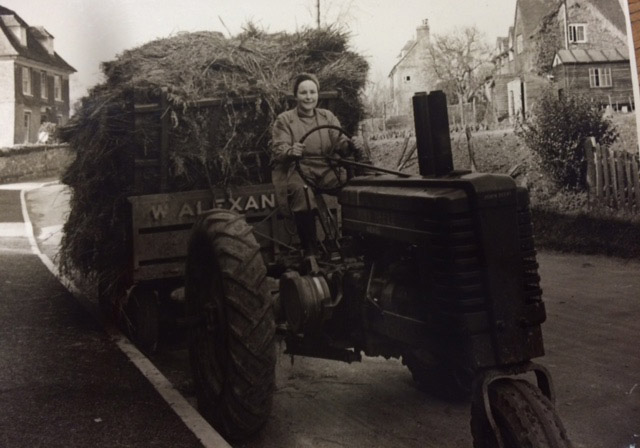 Miss Heddle on a tractor