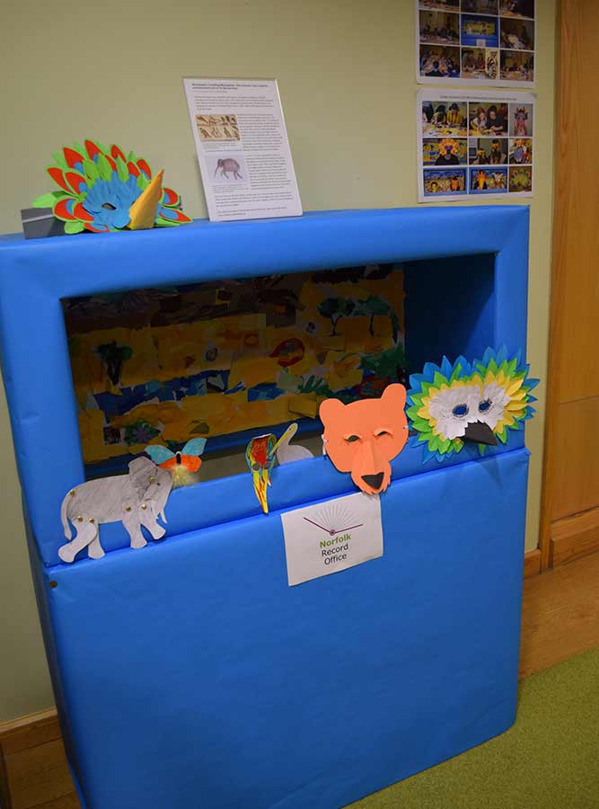 Image of bright blue puppet theatre with animal puppets