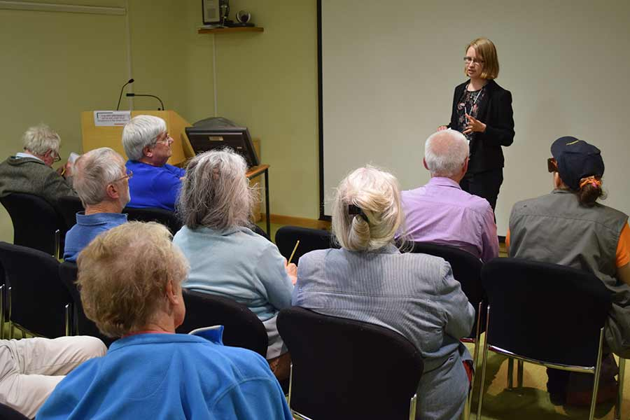 Image of Elizabeth talking to members of the local history society