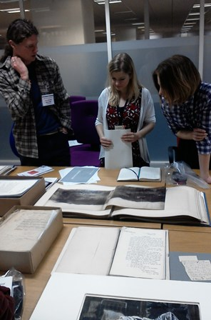 Image of three people looking at documents for initial thoughts and ideas