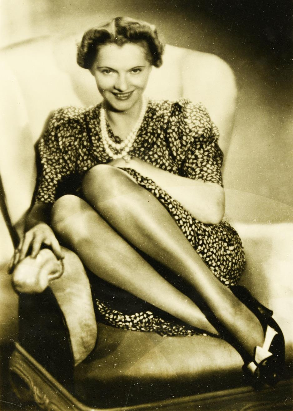 Image of a portrait photograph of a smiling woman - Clara Bauerle - sitting on a chair