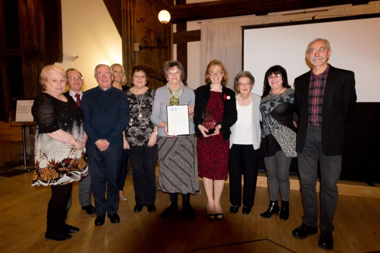 A photograph of volunteers receiving the Archive Volunteering Award for 2015 at the Greater Manchester Archives and Local Studies Partnership Volunteer Awards Ceremony