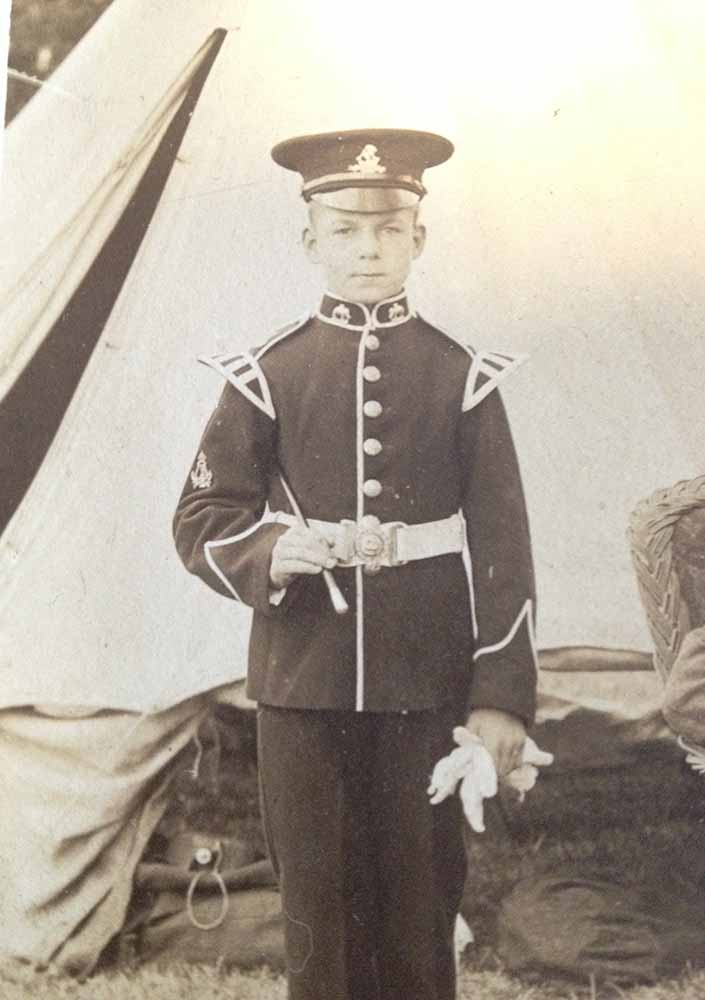 Image of James Stanley Crossley at military camp, wearing a uniform
