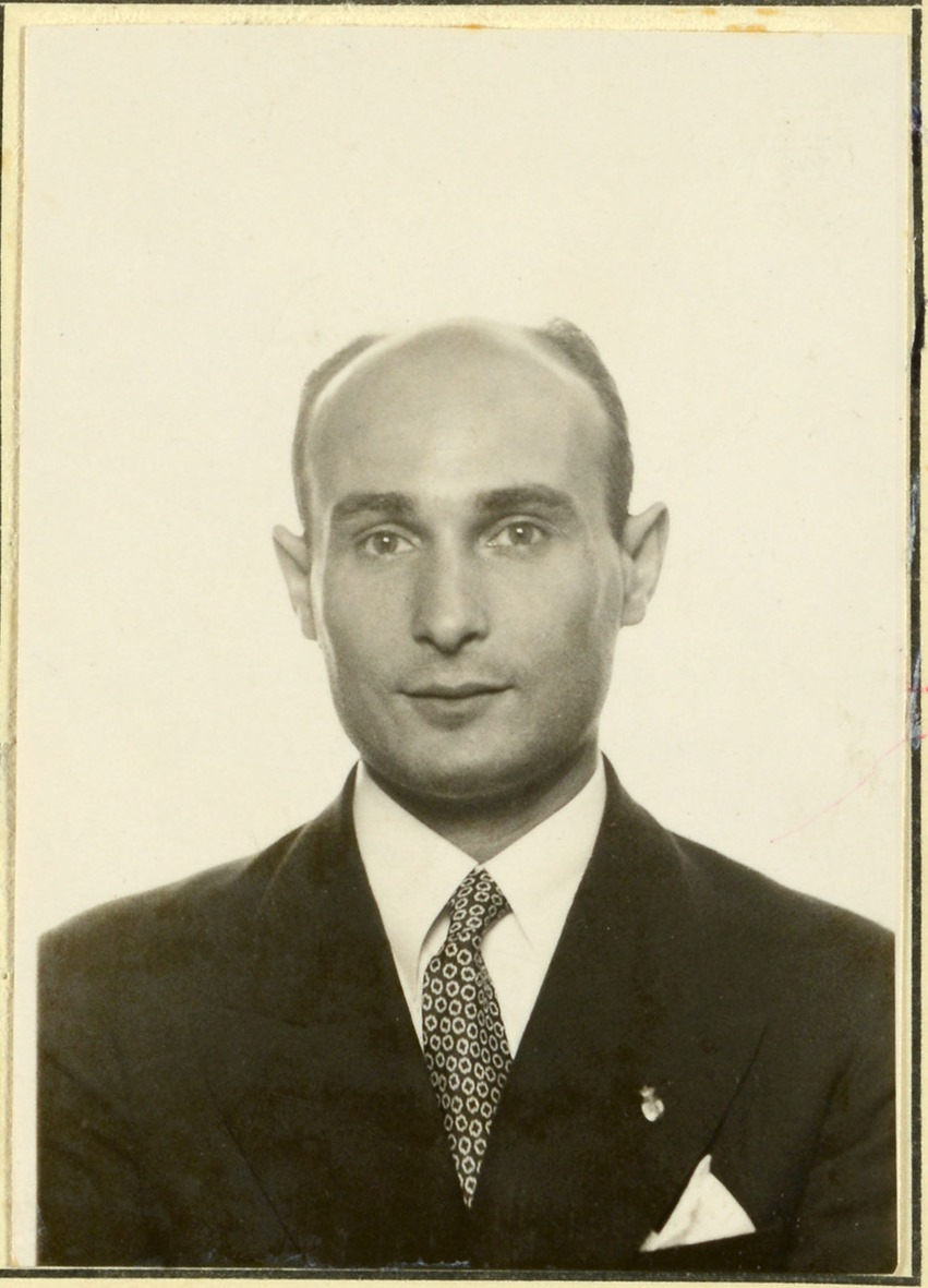 """Image of a portrait photograph of Juan Pujol Garcia or """"Garbo"""" wearing a suit and tie"""