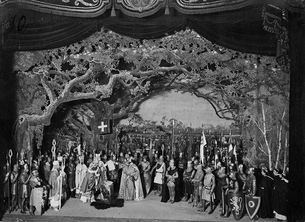 Image of a black and white photograph of an 1899 production of Shakespeare's King John, showing the moment of King John granting Magna Carta