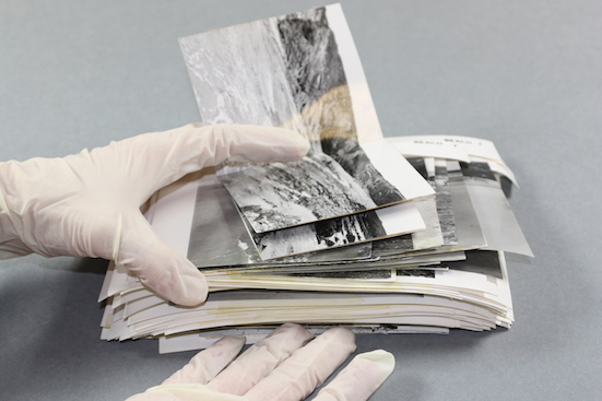 Image of a bundle of photographs that have stuck together