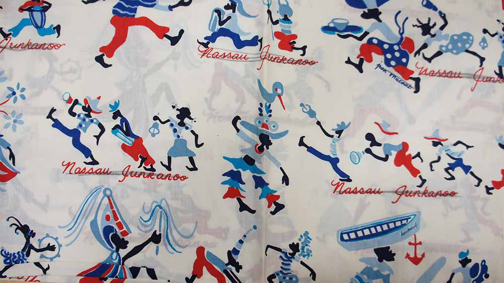 Image of white fabric with figures dressed in blues and reds
