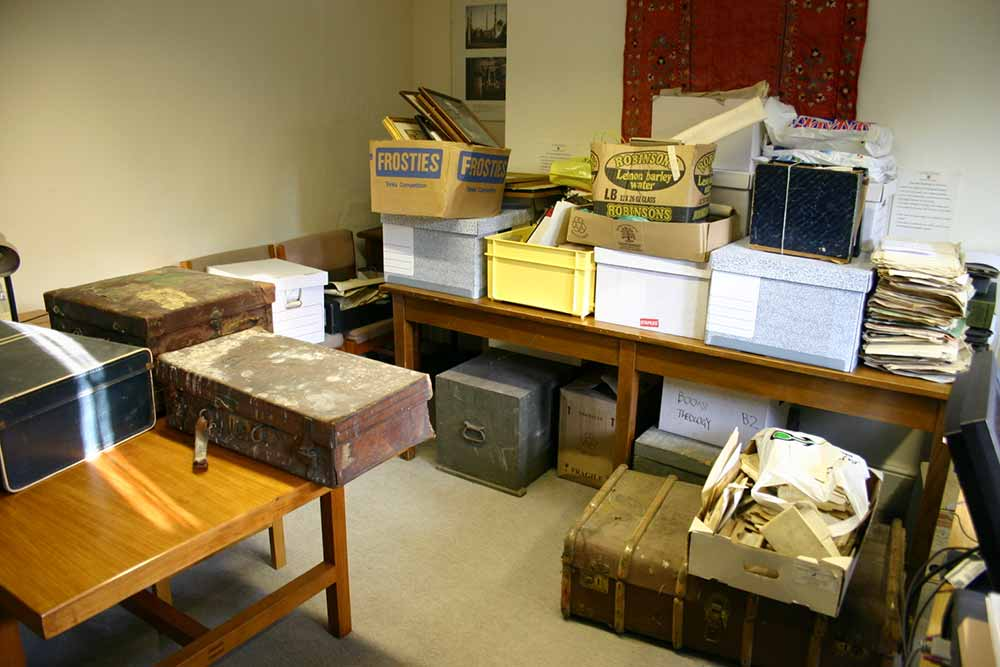 A colour photograph of tables covered in boxes