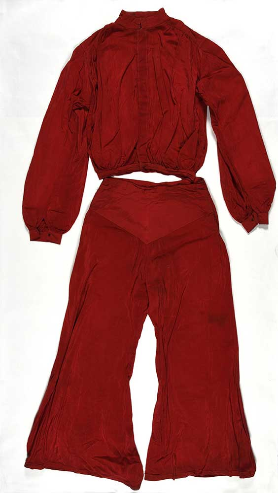 Image of a bright red lounge suit