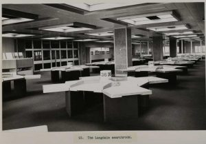 Black and white image of desks in the reading rooms at Kew