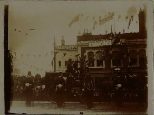 Photograph of the opening of Kew Bridge showing carriage with King's Indian attendants, soldiers in foreground