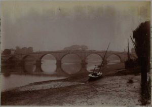 Photograph of Kew Bridge from the North East showing shore and boat, taken October 1894