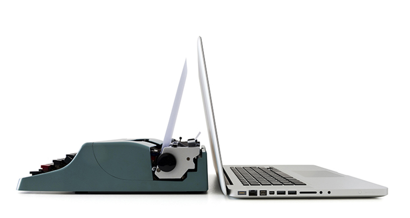 Contemporary laptop facing an old vintage typewriter