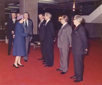 pro 62/7: Three months after the building's official opening in November 1977, , the Queen made an official visit