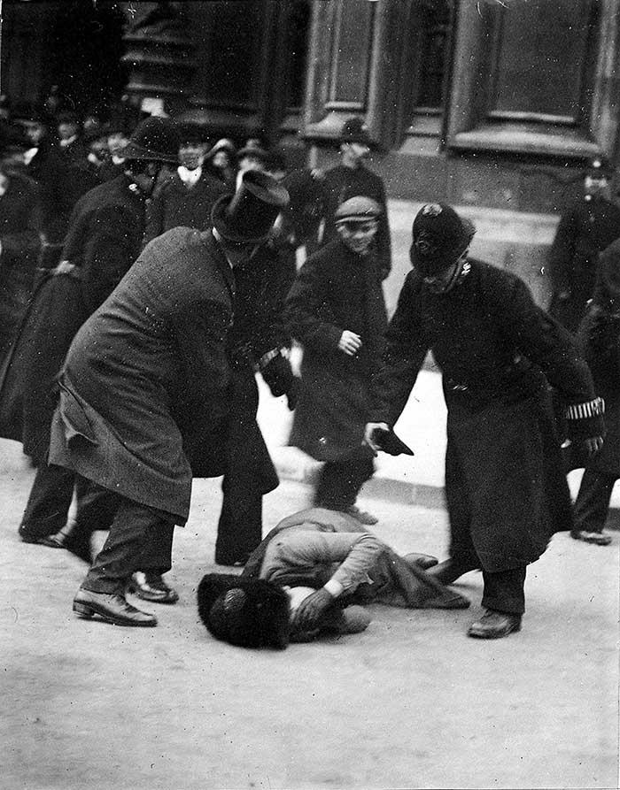COPY1-551 Believed to be suffragette Mrs Ernestine Mills, and Dr Herbert Mills in top hat, Black Friday demonstration, 18 November 1910