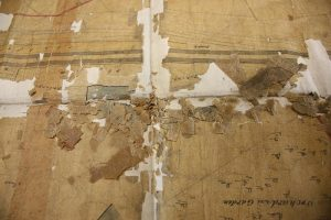 typical damage - creasing, lost areas and loose fragments