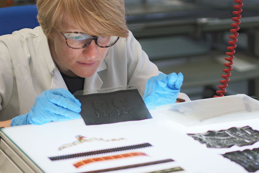 Jacqueline checking the condition of film negatives