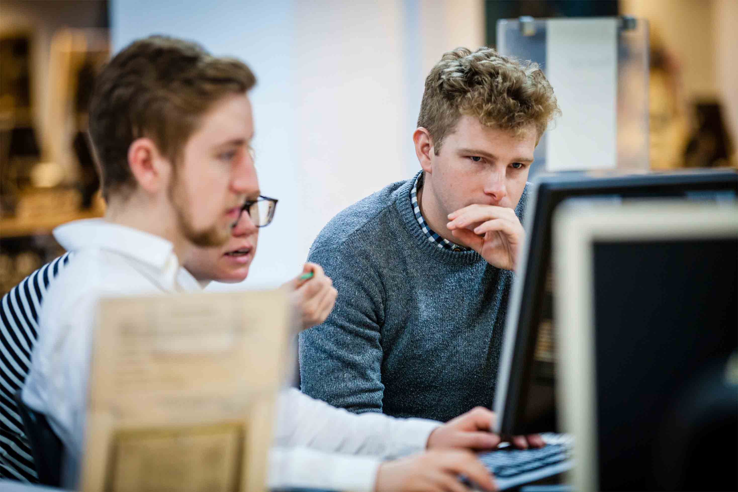 Readers looking at a computer