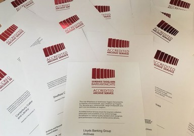 An image of some of the most recent Archive Service Accreditation awards, ready for presentation.