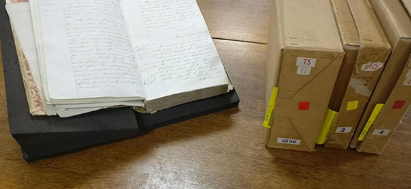 A selection of some the documents consulted by the crew at The National Archives. Alt text: A selection of some the documents consulted by the crew at The National Archives, pictured are HO 79/4 (open volume), TS 11/1056, HO 79/3 and HO 41/4