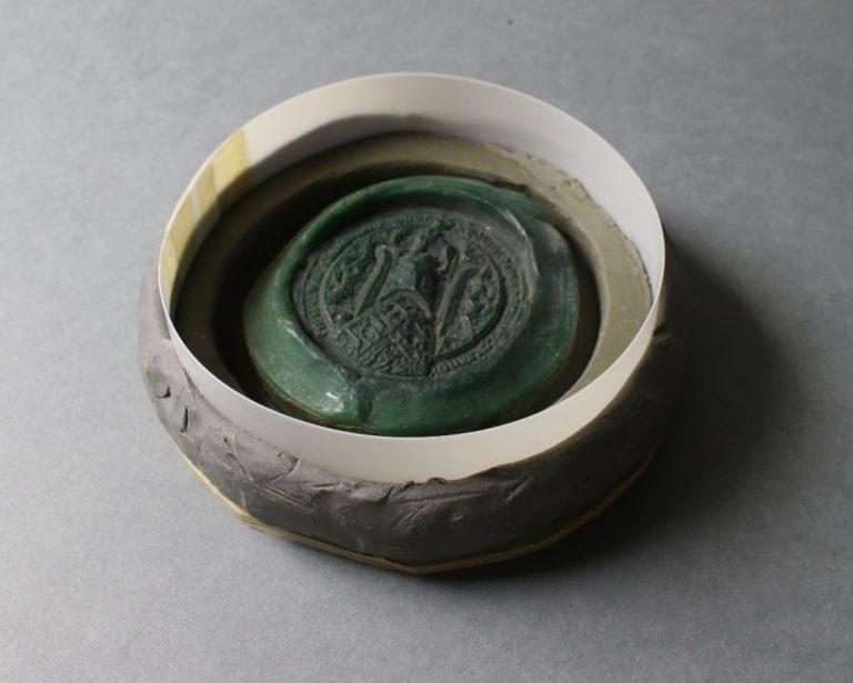 A (replica) seal prepared for the moulding process