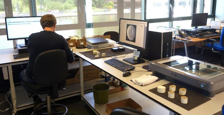 A volunteer scanning moulds and creating metadata