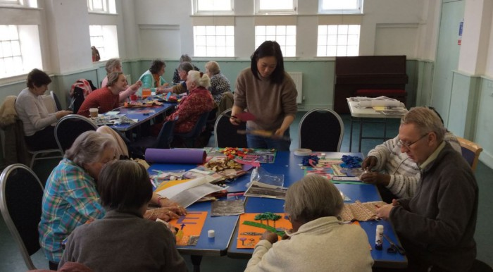 Participants making the collages and memory boxes with help from Ann, Michael and Emma