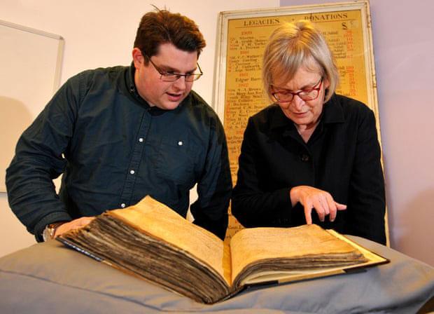 Gary Brannan and Sarah Rees Jones examine one of the archishops' registers. Photograph: University of York