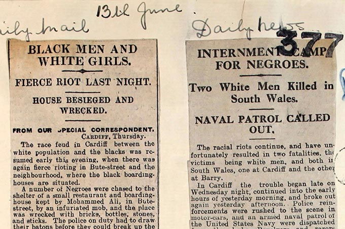 Two extracts of newspaper stories covering the riots. The cutting on the left is titled 'Black Men and White Girls'.